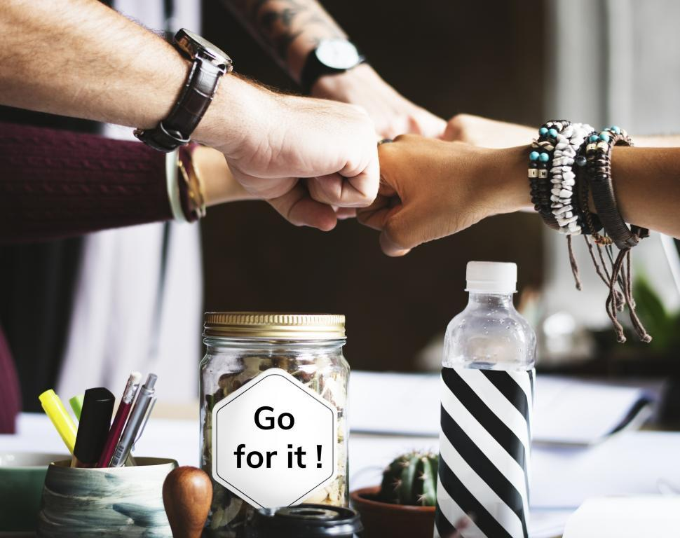 Download Free Stock Photo of A business team Giving Fist Bump in agreement