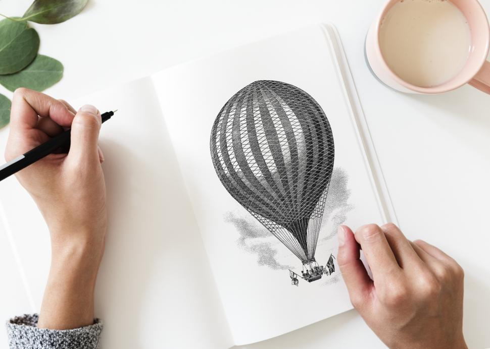 Download Free Stock Photo of Over the head view of a hand drawing on a sketch book
