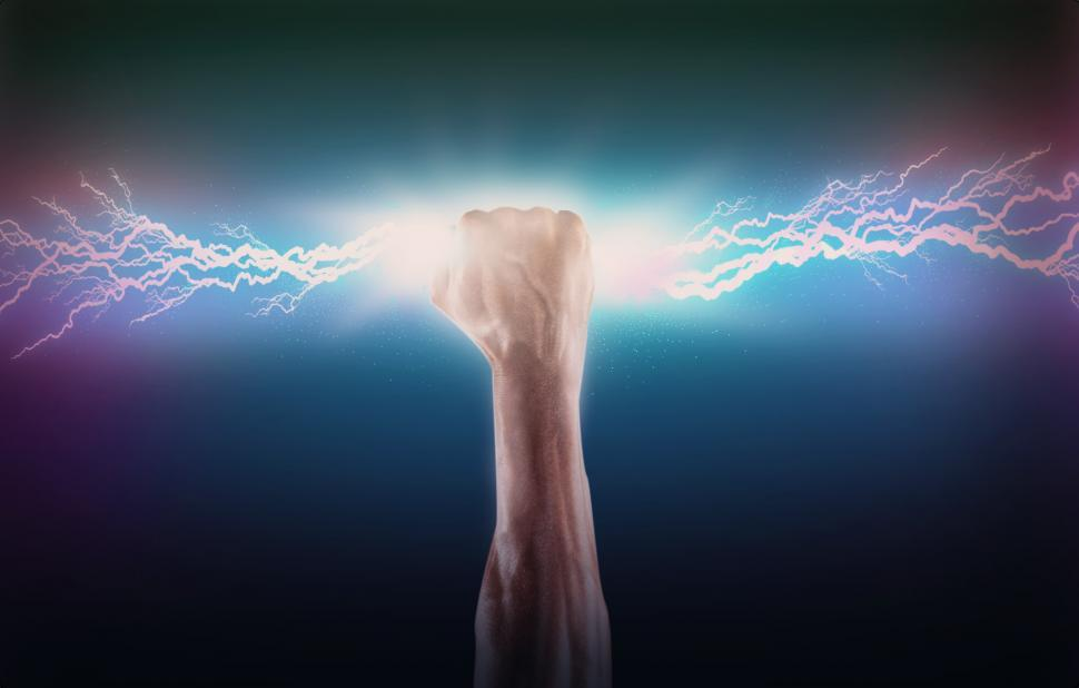 Download Free Stock Photo of Clenched Fist Grabbing Lightning Bolt - Ambition and Determinati