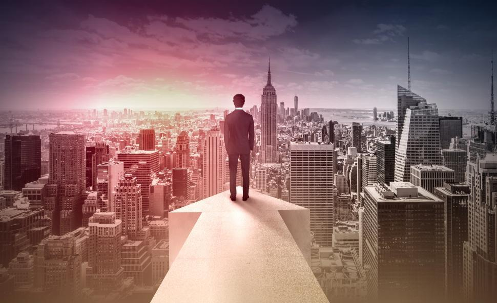 Download Free Stock Photo of Businessman On Arrow Over Manhattan - New York - Success and Achievement Concept