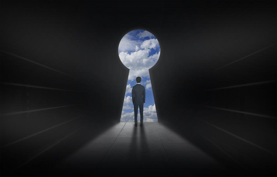 Download Free Stock Photo of Man and Keyhole - Opening Up a World of Possibilities