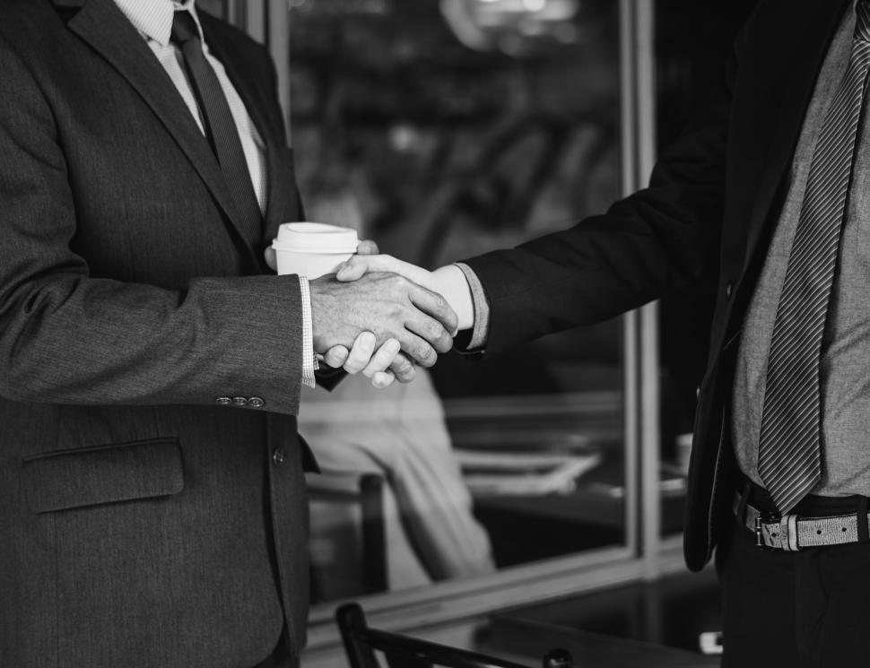 Download Free Stock HD Photo of Handshake between two businesspeople, black and white Online