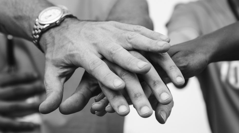 Download Free Stock Photo of Hands stacked together - black and white