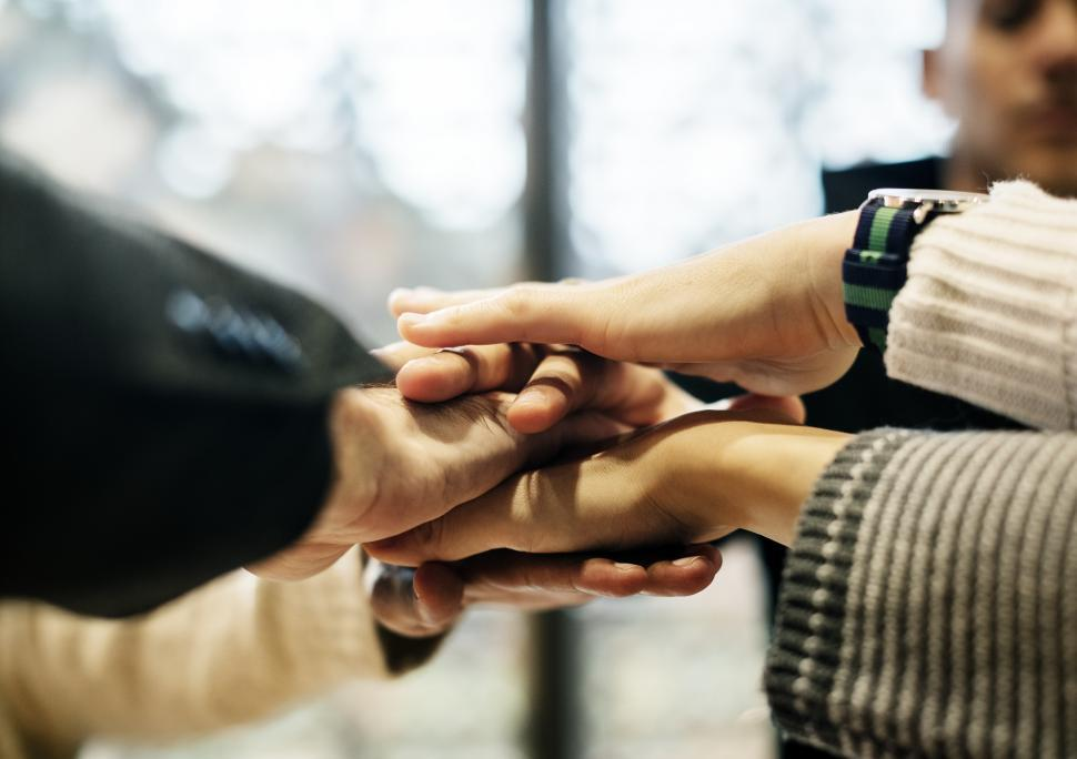 Download Free Stock Photo of Hands of team stacked together in a meeting
