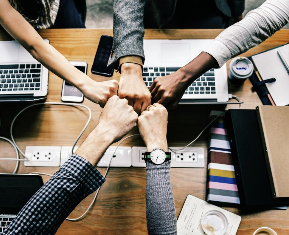 Download Free Stock Photo of A business team giving group Fist Bump in agreement