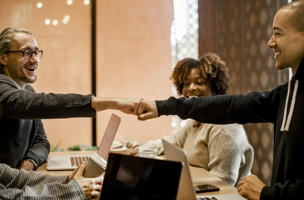 Download Free Stock Photo of Colleagues giving Fist Bump in agreement during meeting