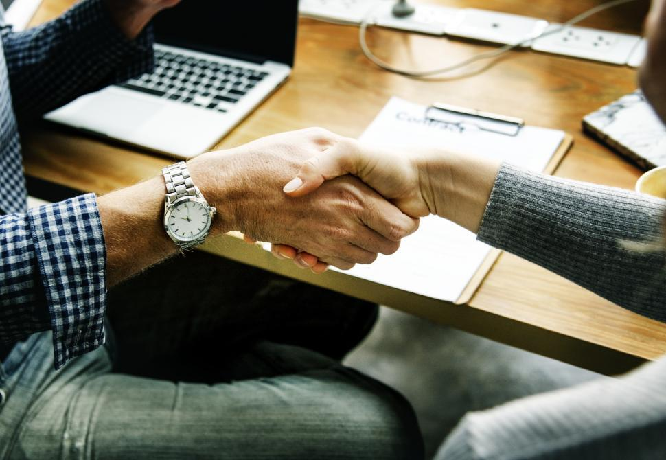 Download Free Stock HD Photo of Seated people shaking hands Online