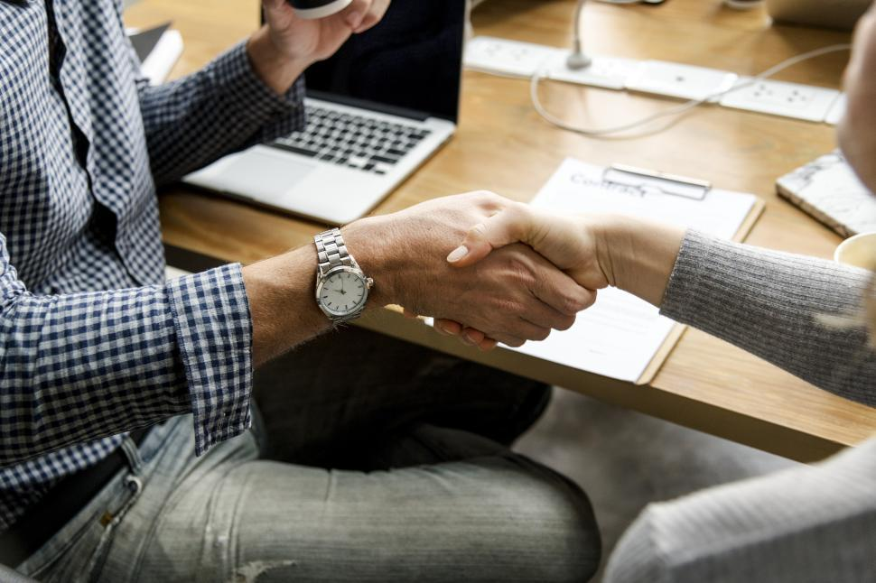 Download Free Stock Photo of Greeting handshake between two business people