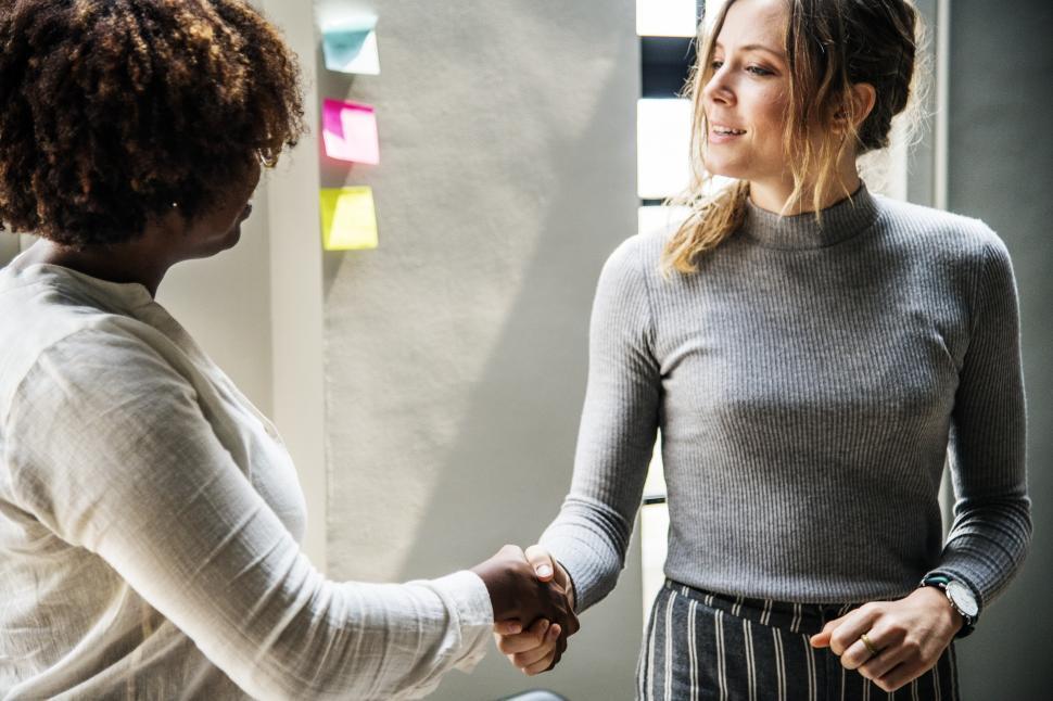Download Free Stock HD Photo of Handshake between two business women Online