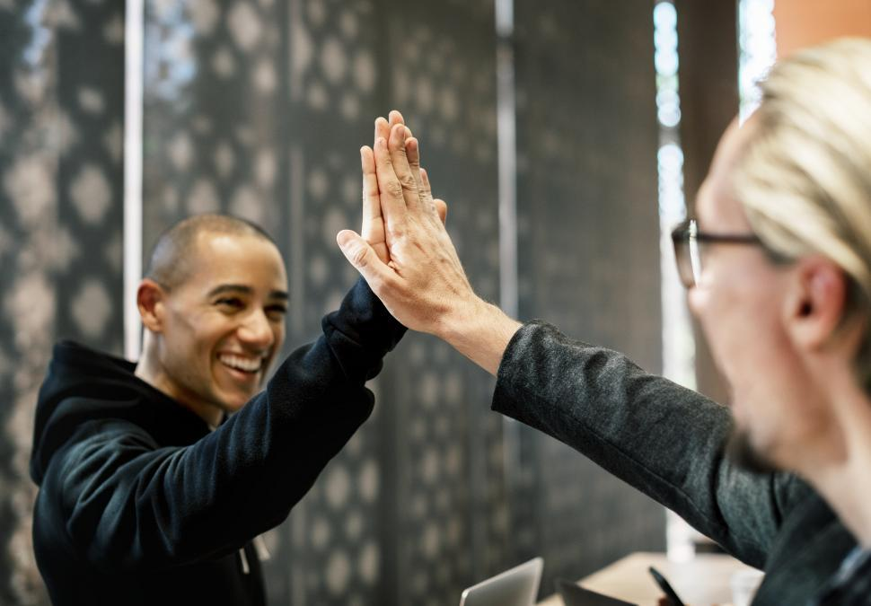 Download Free Stock Photo of Coworkers giving a high five
