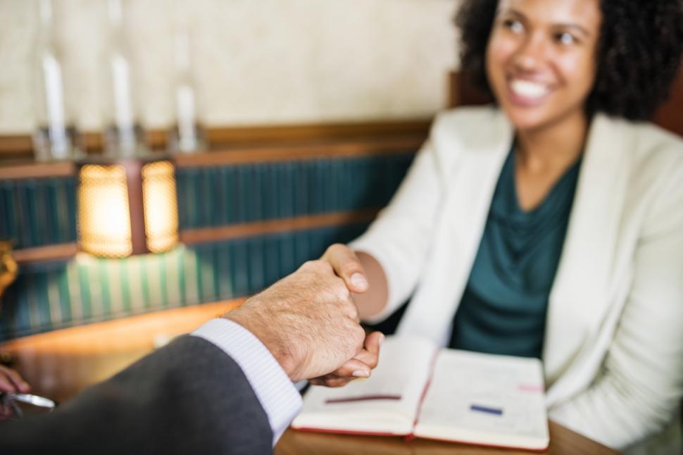 Download Free Stock Photo of Polite handshake between two business people