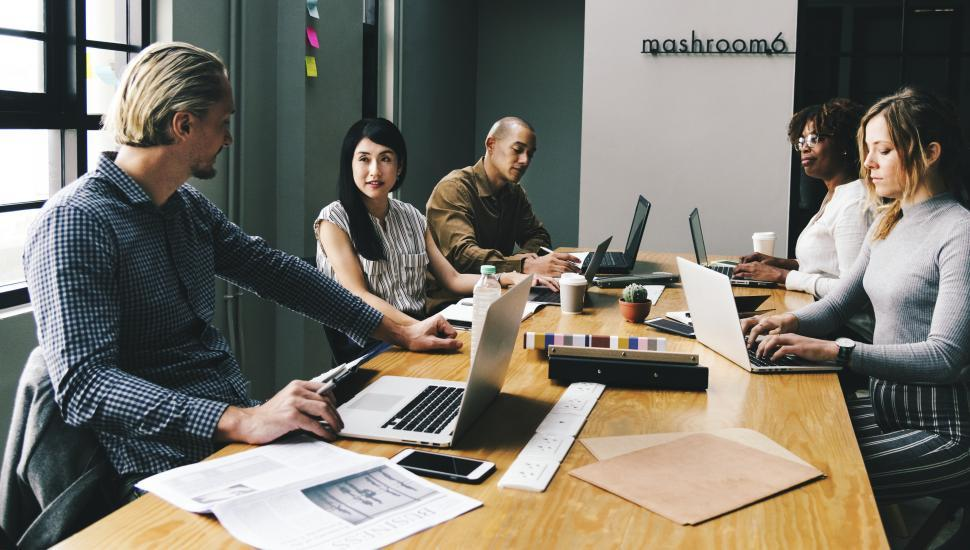 Download Free Stock HD Photo of Group working together at an office Online