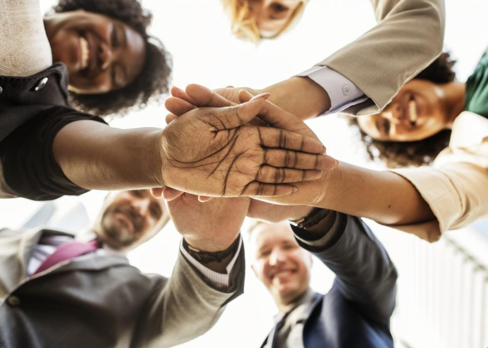 Download Free Stock HD Photo of Hands grouped together in a huddle Online