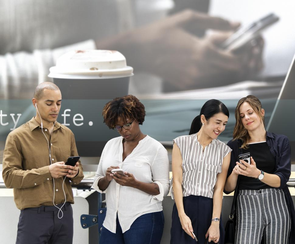 Download Free Stock HD Photo of Group of people looking at their mobile phones Online