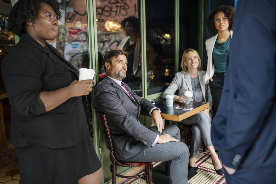 Download Free Stock HD Photo of Multiethnicity colleagues outside a cafe Online