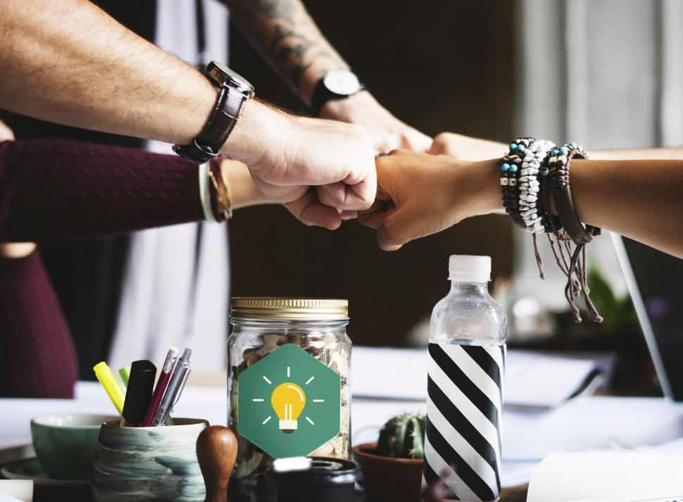 Download Free Stock HD Photo of A business team giving group Fist Bump in agreement Online