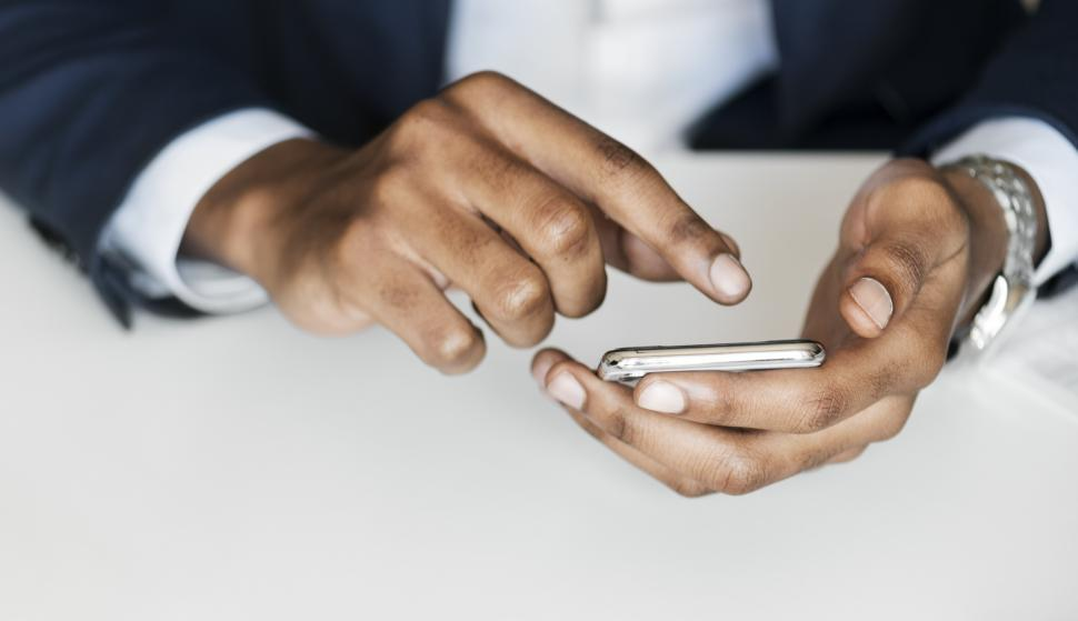 Download Free Stock HD Photo of Close up of hands working with phone screen Online