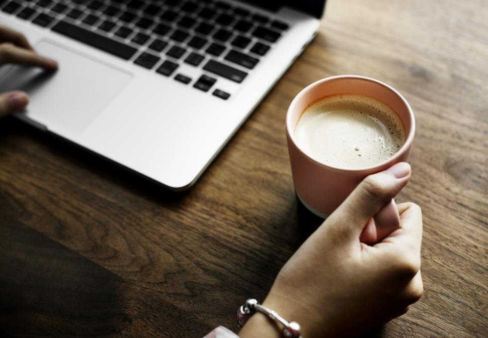 Download Free Stock Photo of Close up of a hand holding coffee mug
