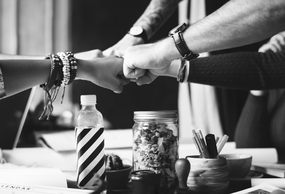 Download Free Stock HD Photo of Black and white photo of team giving Fist Bump in agreement Online