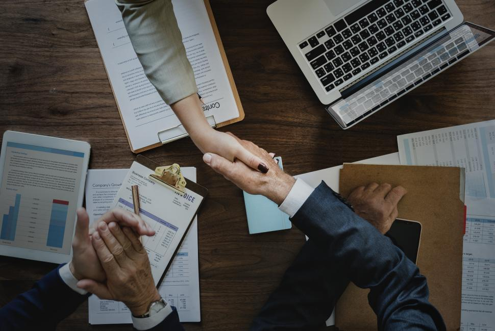 Download Free Stock Photo of Handshake across desk -  two business people