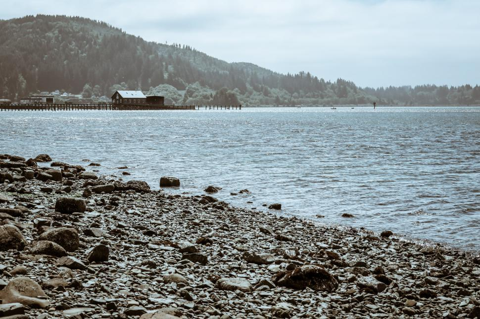 Download Free Stock HD Photo of Cold tint of pier and buildings at the beach Online