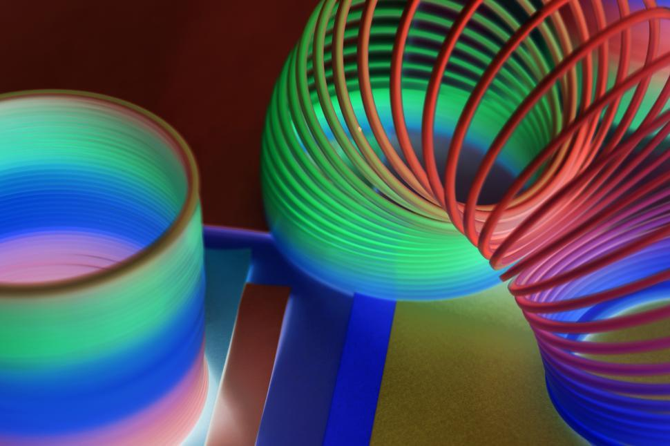 Download Free Stock Photo of Inverted color close up of colorful slinky