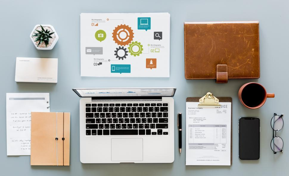 Download Free Stock Photo of Laptop and infographic with other items on the office table