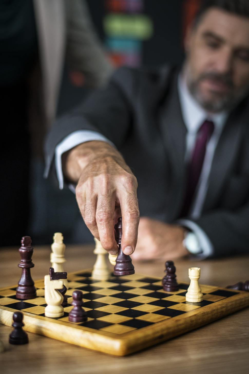 Download Free Stock Photo of Close up of a business man playing chess