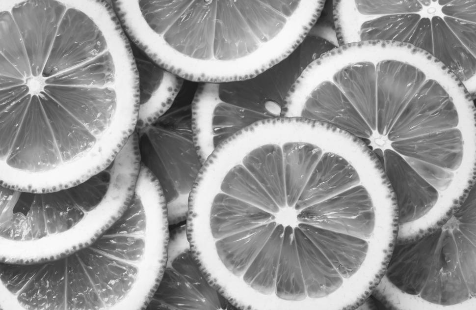 Download Free Stock Photo of Black and white close up of a lemon slices