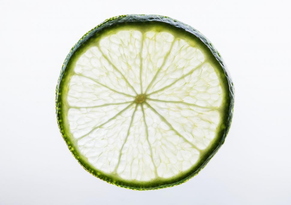 Download Free Stock HD Photo of Back illuminated close up of a lime slice Online