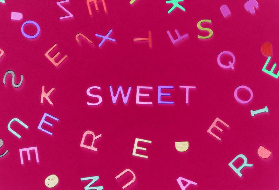 Download Free Stock Photo of Flat lay of the word SWEET written with alphabet blocks