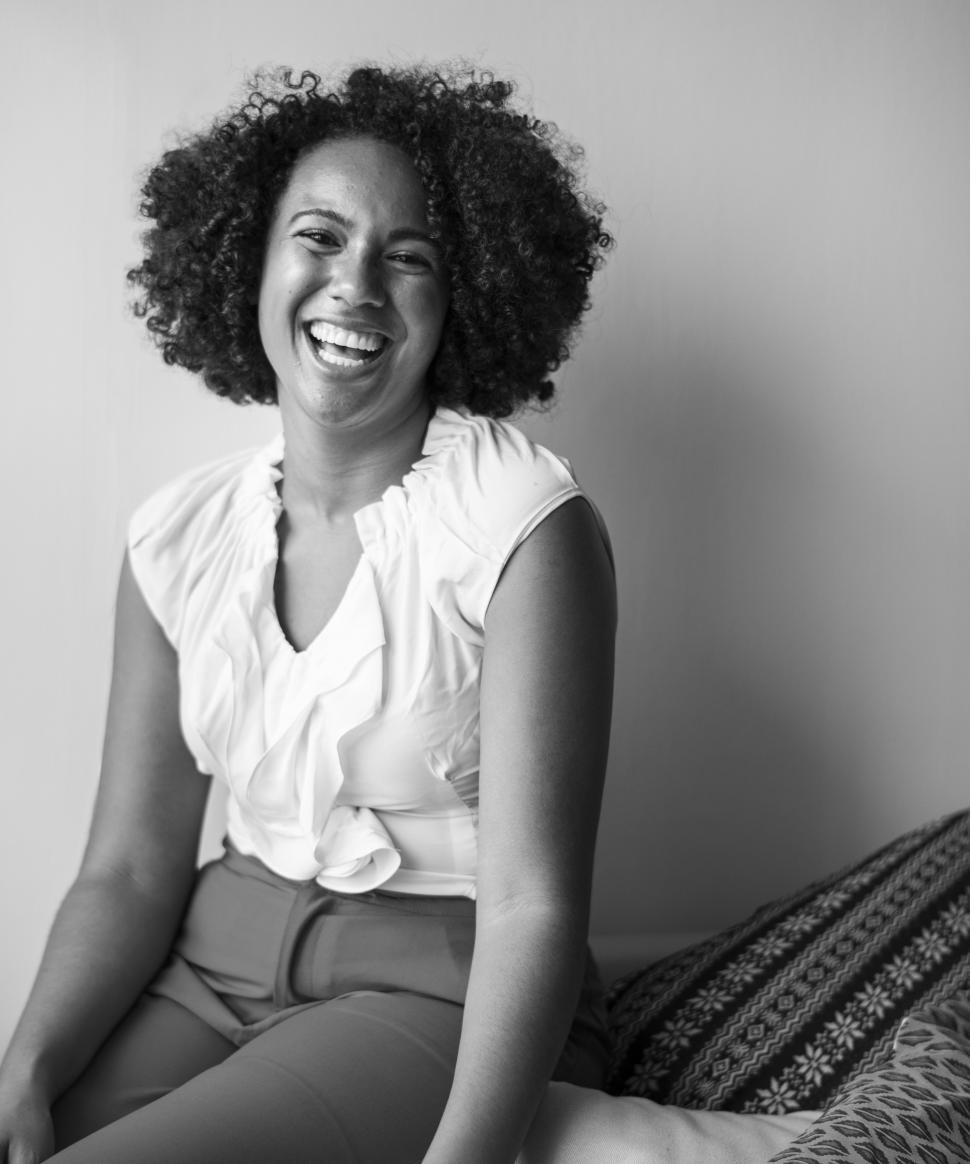 Download Free Stock HD Photo of Woman with curly hair laughing, black and white Online