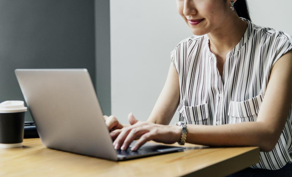 Download Free Stock HD Photo of Woman working on computer - partially obscured Online