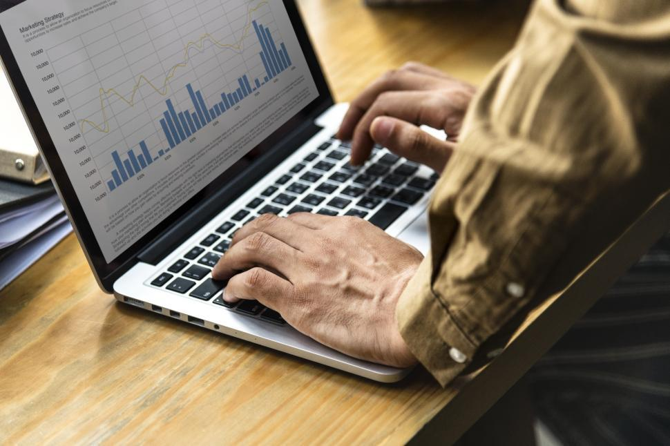 Download Free Stock HD Photo of Hand on a laptop with charts and graphs Online