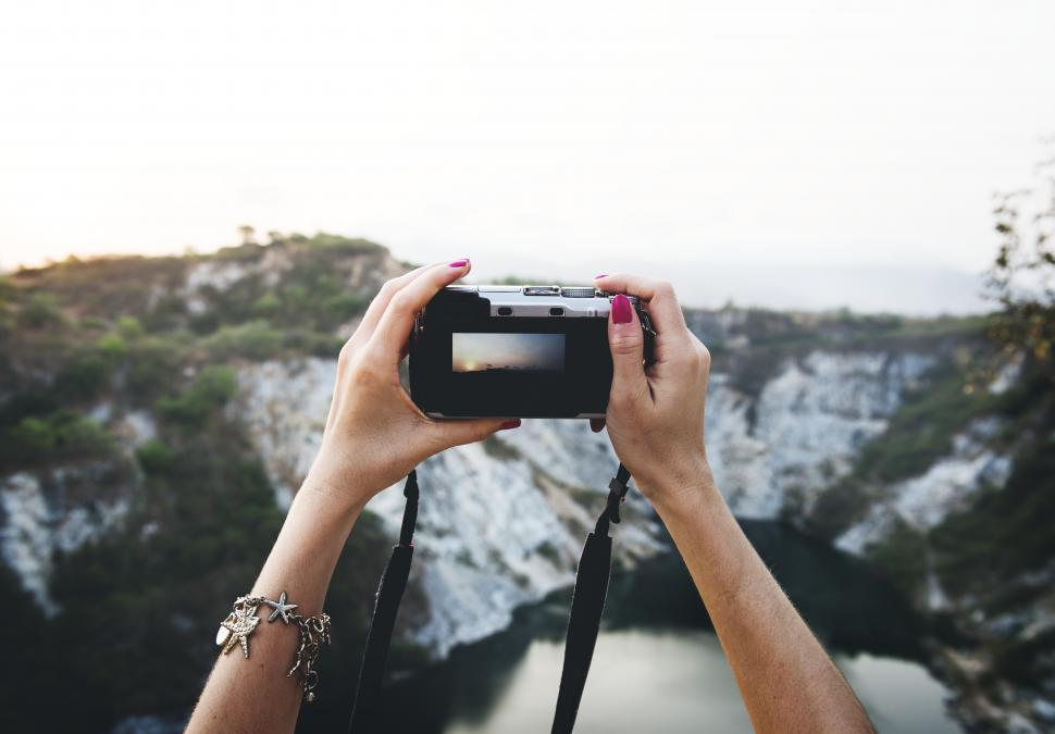 Download Free Stock HD Photo of Close up a hands holding a camera to take photo Online