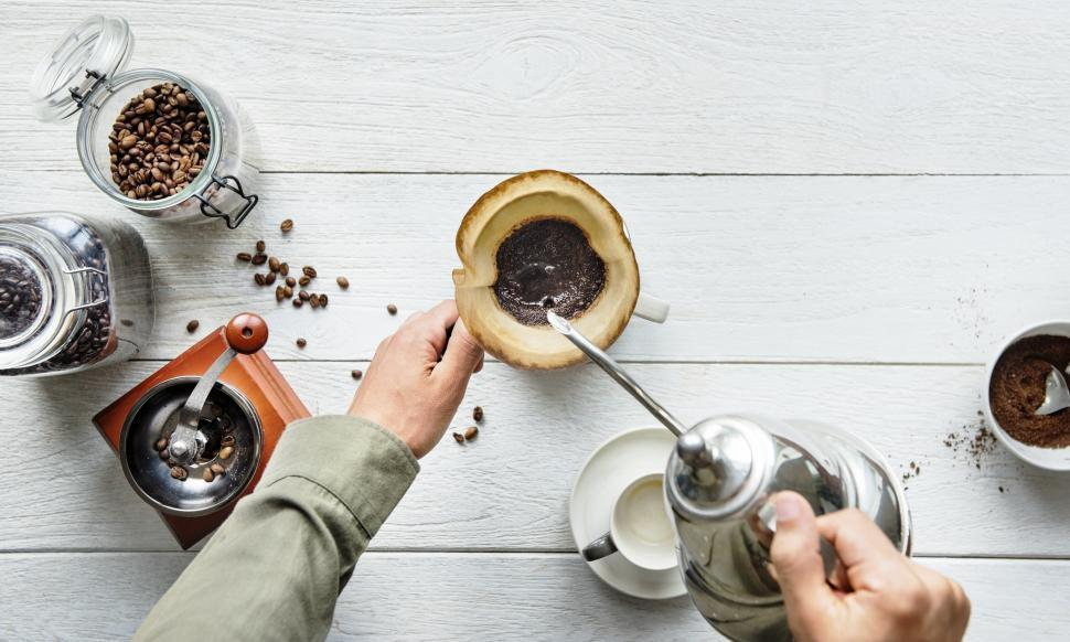 Download Free Stock HD Photo of Hot water being poured over coffee filter cone with coffee accessories Online