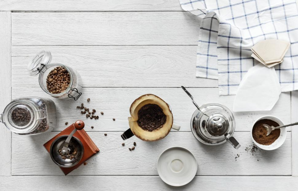 Download Free Stock HD Photo of Overhead of water kettle and coffee filter cone Online