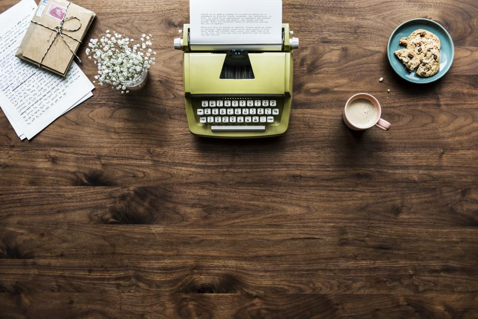 Download Free Stock Photo of Overhead background of a vintage typewriter and desk items