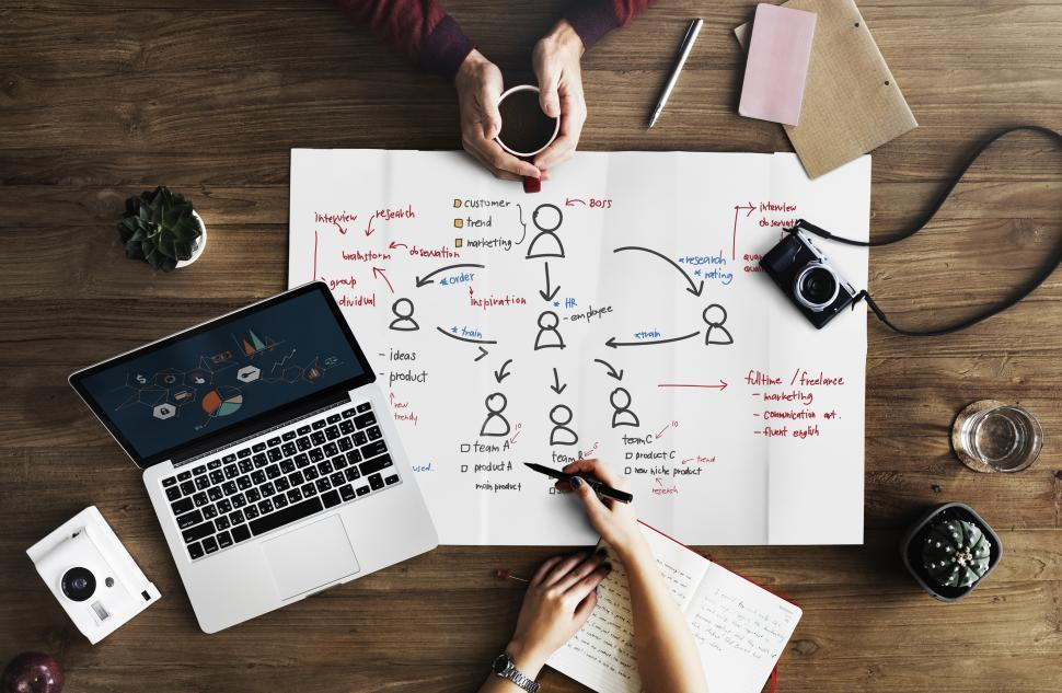 Download Free Stock Photo of Flat lay of a laptop and a coffee mug with an org chart illustration