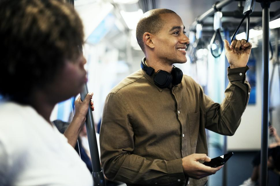 Download Free Stock Photo of A young passenger in a train