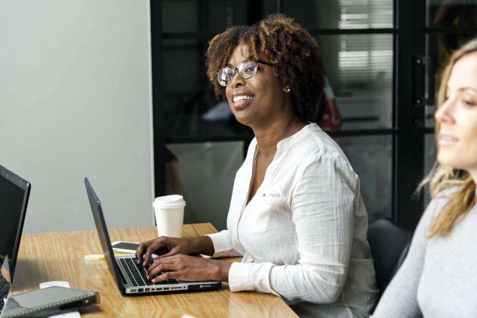 Download Free Stock HD Photo of An African ethnicity woman with her colleague in a business meeting Online
