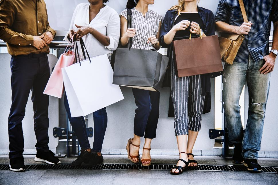 Download Free Stock HD Photo of Shopping bags and a group of multiethnic shoppers Online