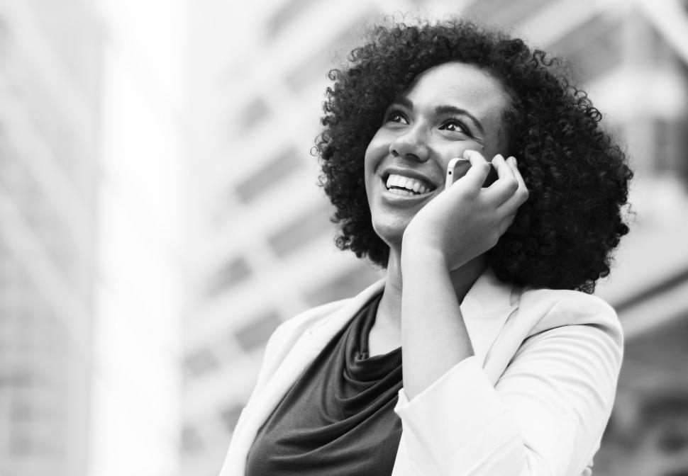 Download Free Stock HD Photo of Black and white photo of woman speaking on a mobile phone Online
