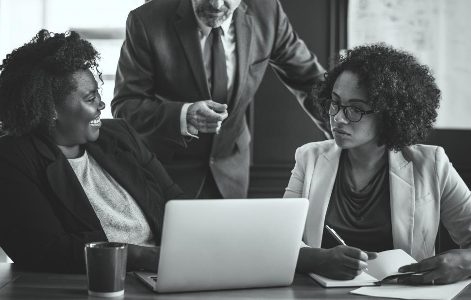 Download Free Stock HD Photo of Colleagues in a business meeting - black and white photo Online