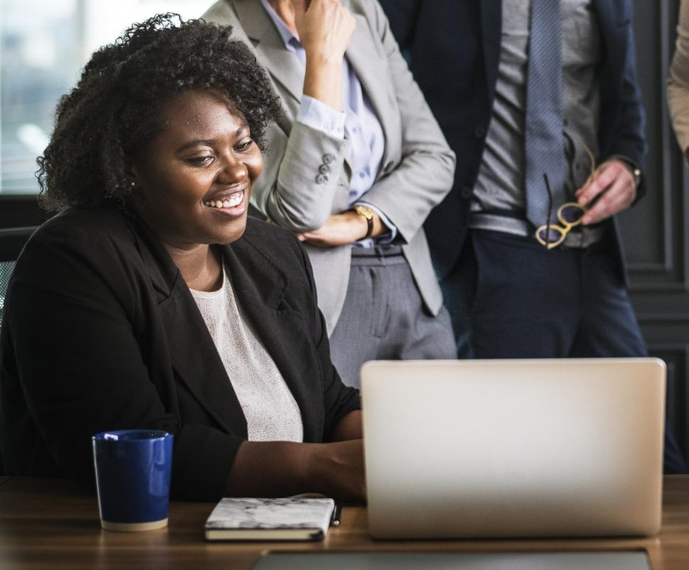 Download Free Stock HD Photo of A woman and her laptop with her colleagues in a business meeting Online