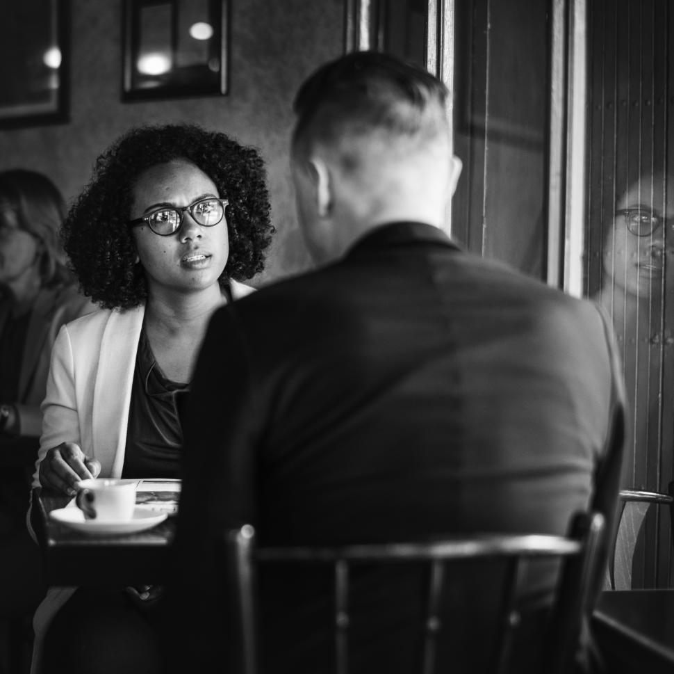 Download Free Stock HD Photo of Two businesspeople at a cafe in black and white Online