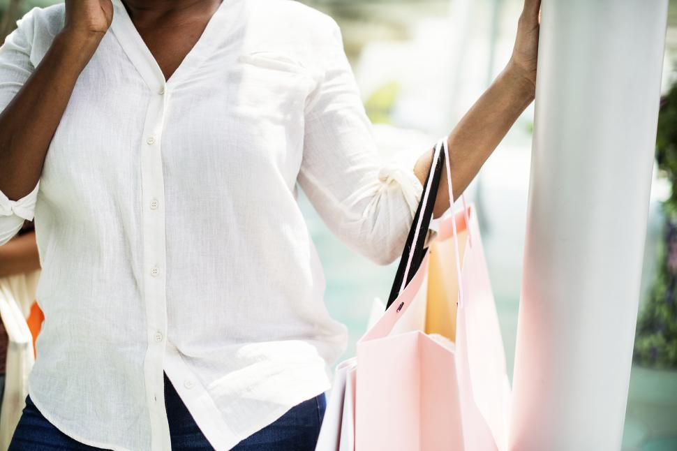 Download Free Stock HD Photo of Close up of a woman carrying shopping bags Online
