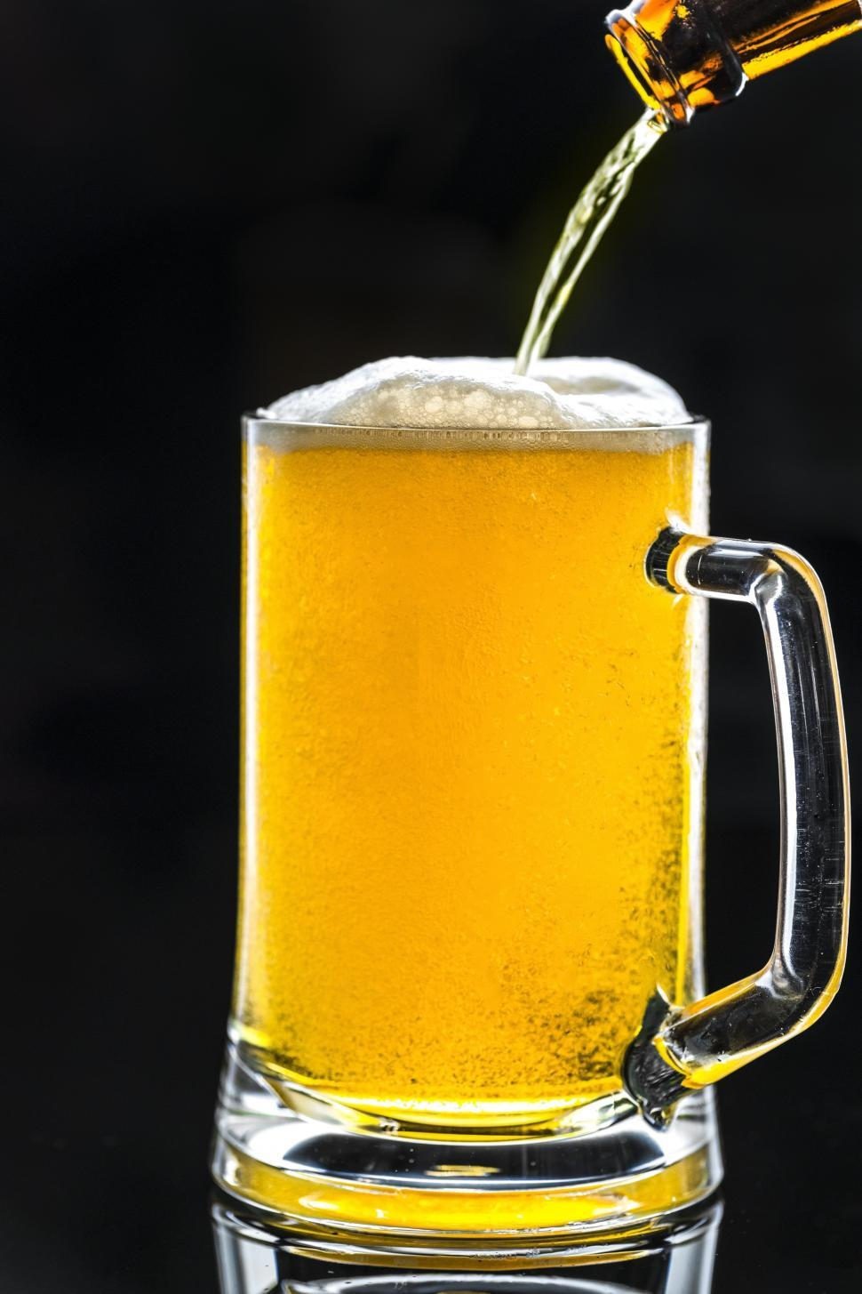 Download Free Stock HD Photo of Beer being poured into a pint mug Online