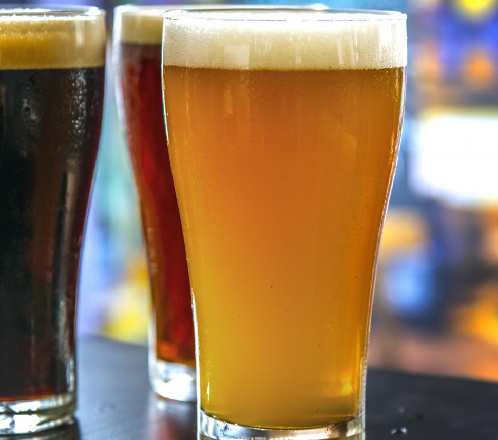 Download Free Stock HD Photo of Close up of beer served in pint glasses Online
