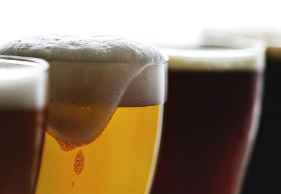 Download Free Stock Photo of Close up of overflowing beer foam